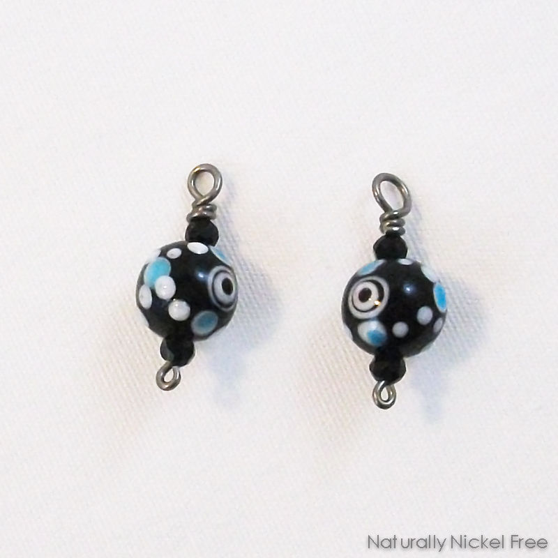 Black Glass Bead Charms with Blue and White Accents - product image