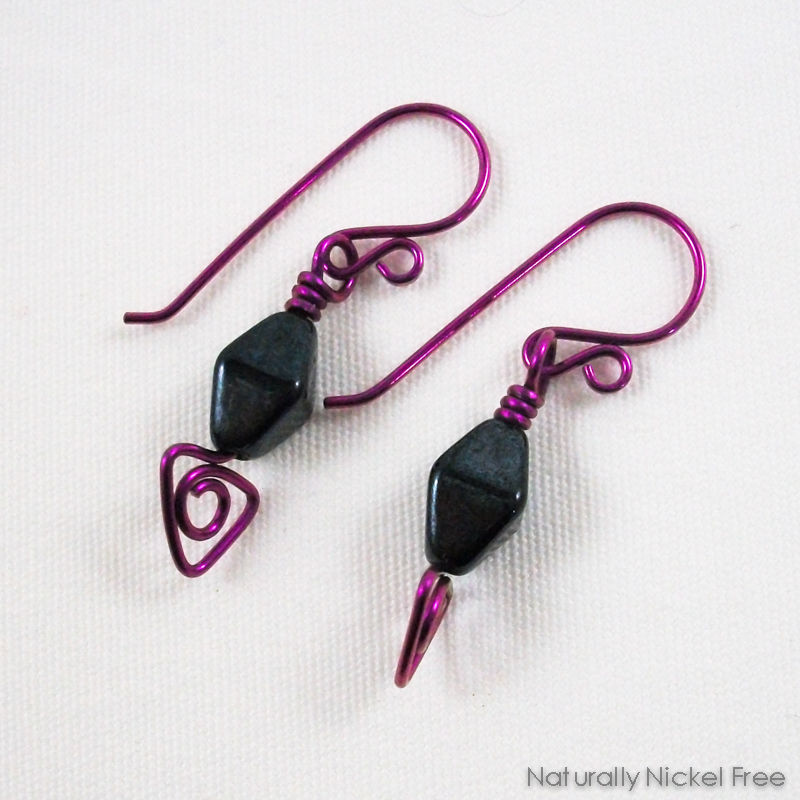 Black Glass Bead Earrings with Magenta Niobium Wirework - product images  of