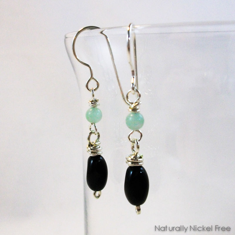 Black Glass Earrings with Green Gemstone Accent - product image
