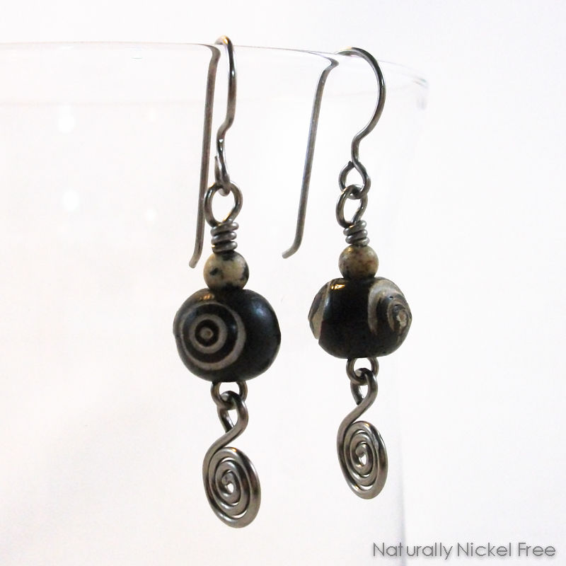 Carved Bone Niobium Earrings with Spiral - product image