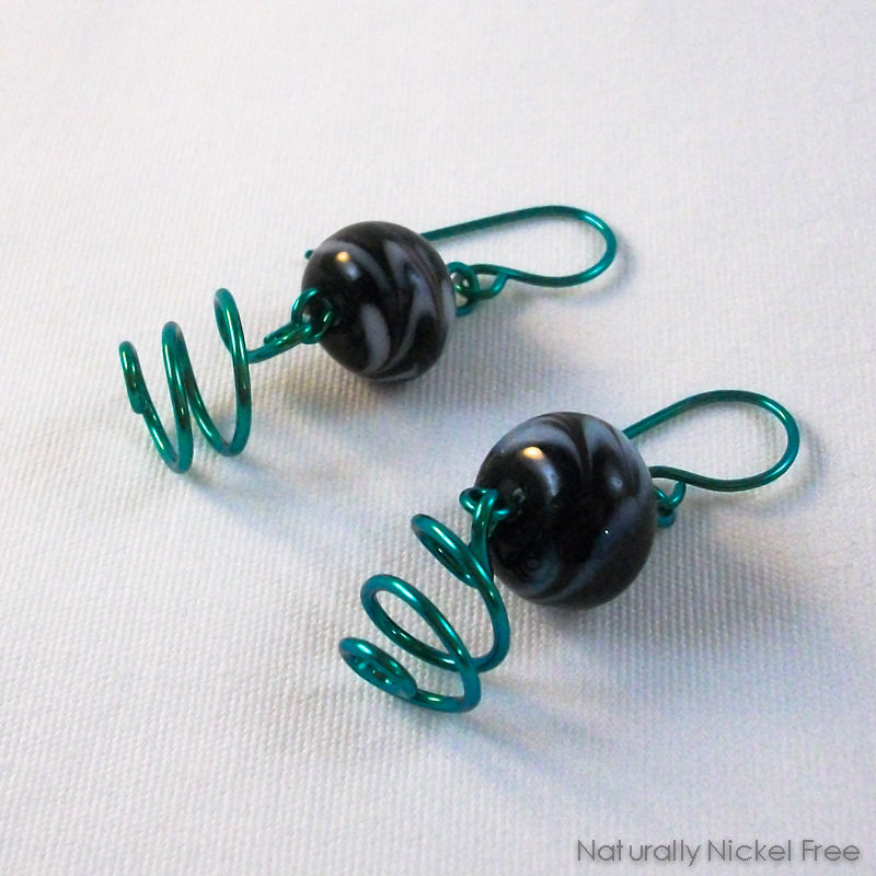 Black Floral Glass Dangles with Slanted Spirals, Anodized Aqua - product images  of