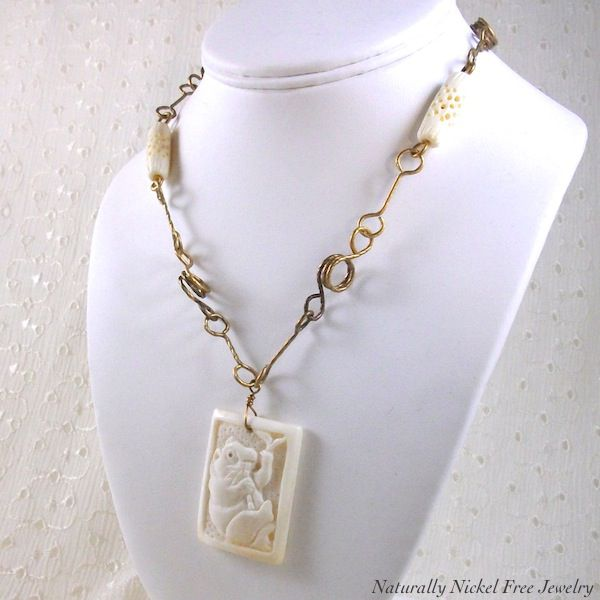 Panda Bear Image, Carved Bone Pendant with Wrapped Brass Wire Chain - product image
