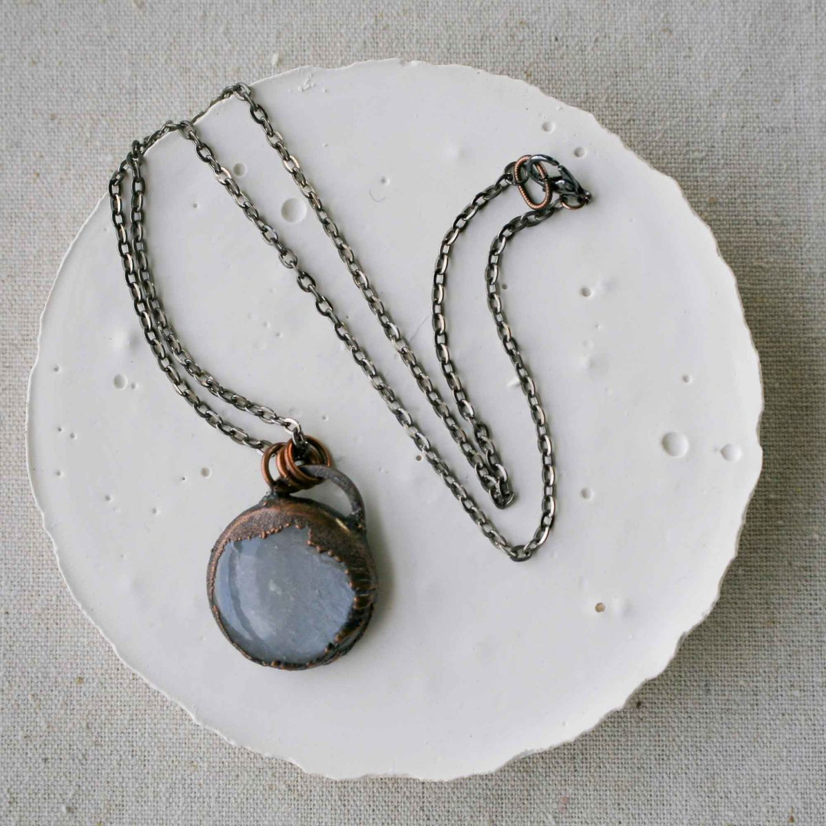 Smooth Polished Moonstone Pendant on Dark Electroformed Copper - product images  of