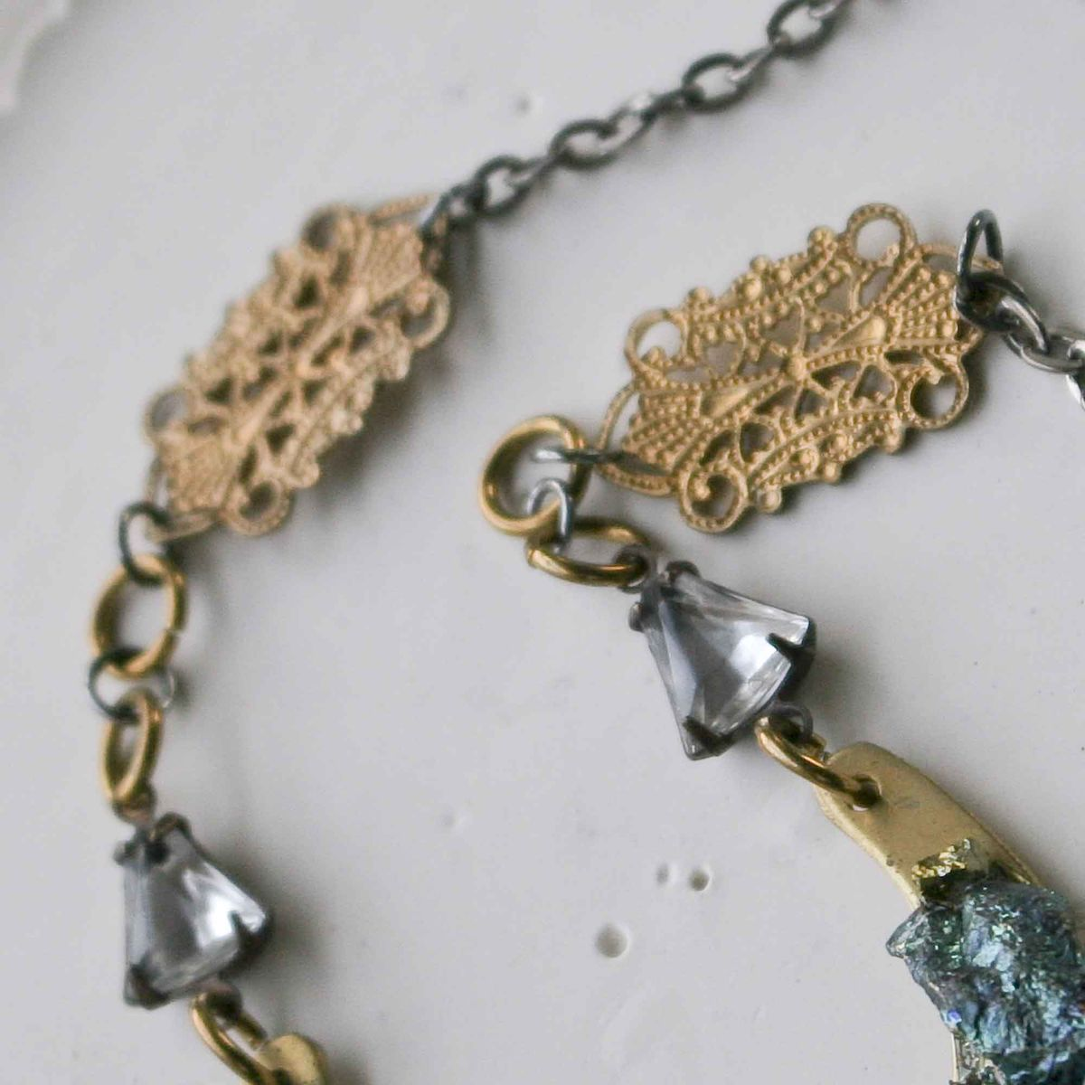 Peacock Ore Stones on a Brass Crescent Pendant Necklace - product images  of