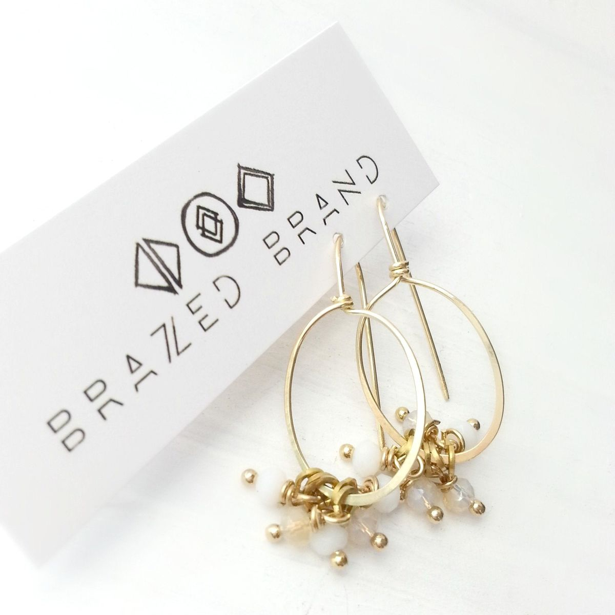 Yellow Brass Oval with White and Champagne Dangle Beaded Earrings - product images  of