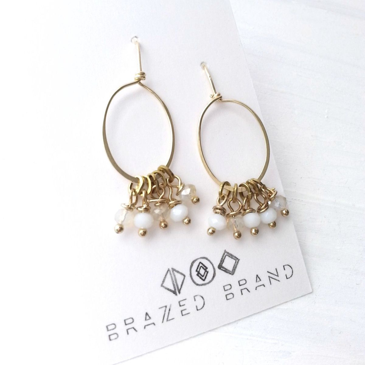 Yellow Brass Oval with White and Champagne Dangle Beaded Earrings - product image
