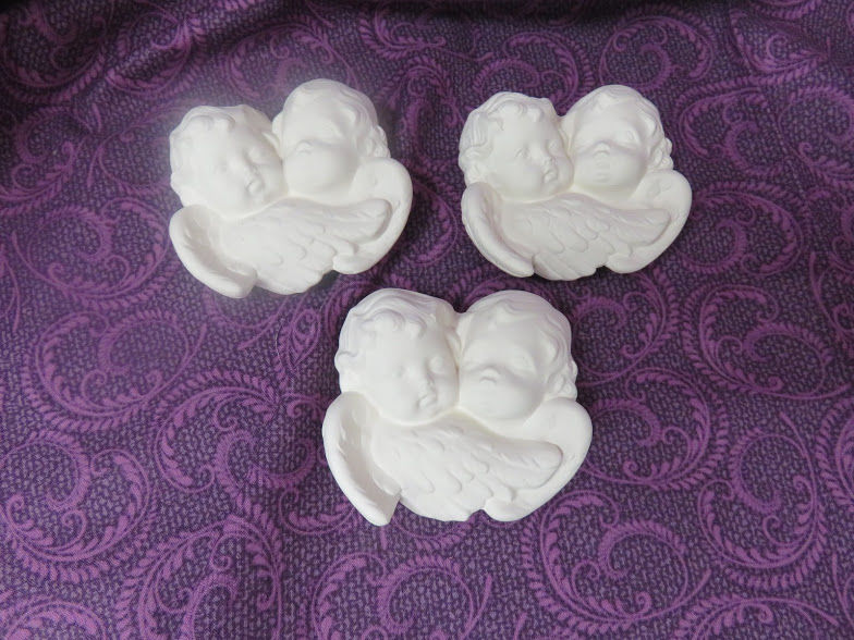 Set of three Double Cherub Head Ornaments Unpainted Ceramic Bisque - product images