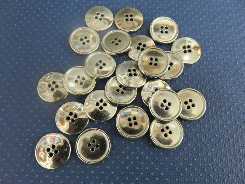 Silver Four Hole Buttons Package of 50 pieces - product image