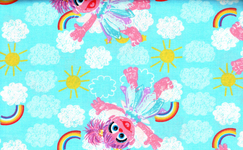 Cotton Quilt Fabric Sesame Workshop Dolls Clouds Rainbows Blue  - product image