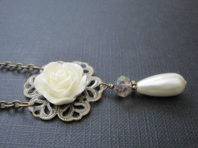 Victorian white rose elegant gray feathers pearls