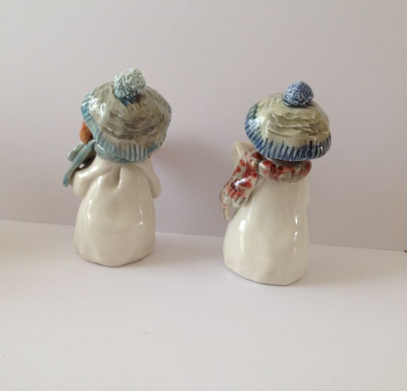 Small carol singers with blue hats and scarves - product image