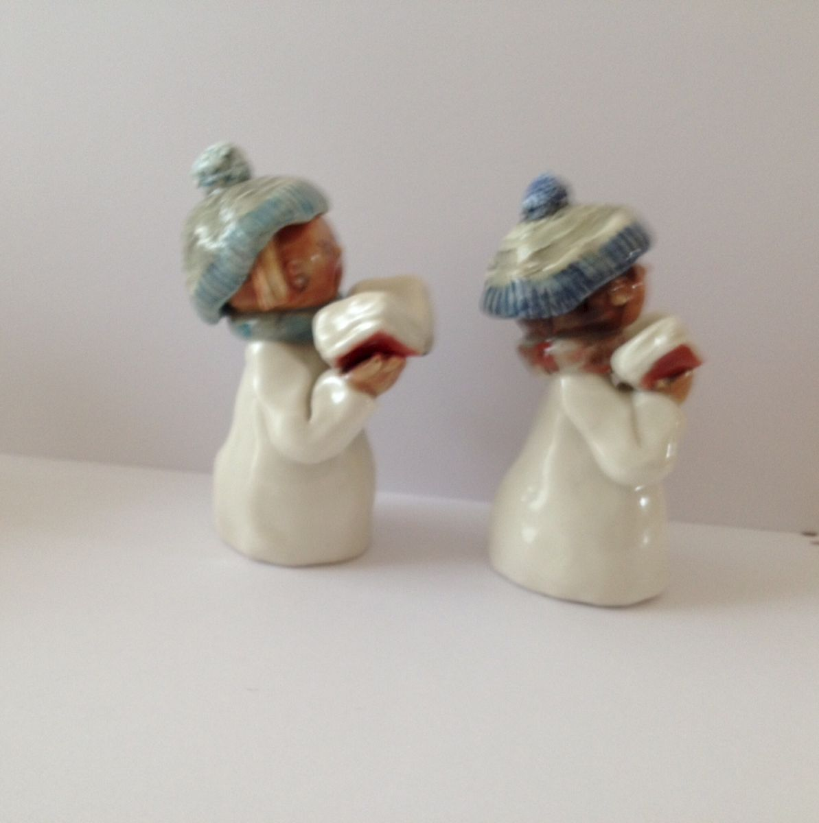Small carol singers with blue hats and scarves - product images  of