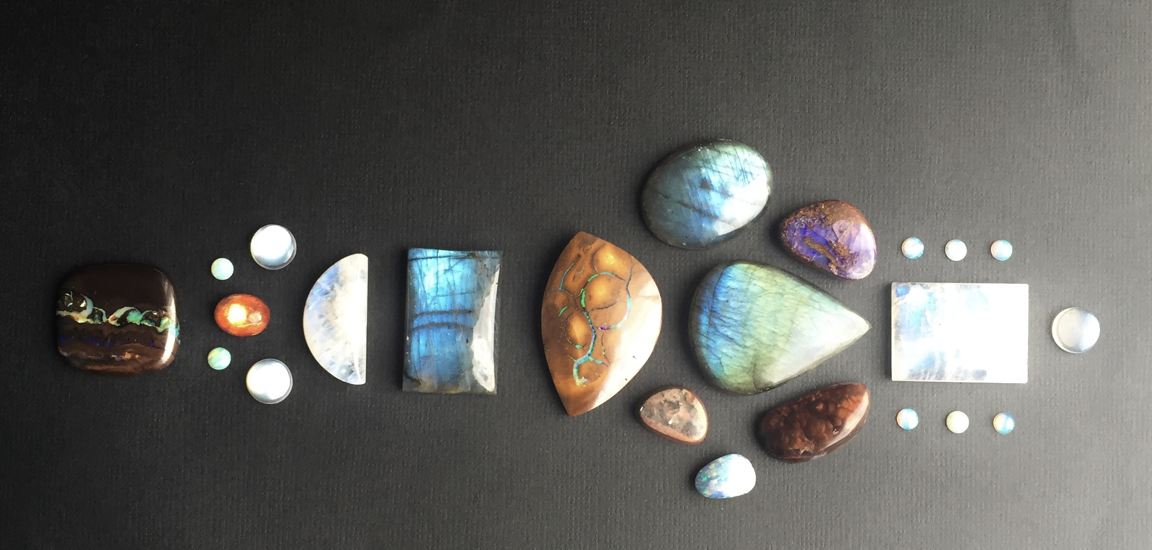 Labradorite, Moonstone, Sunstone, Australian Opal and Boulder Opal Cabochons waiting to be set in my handfabricated sterling silver and 18K gold jewelry.