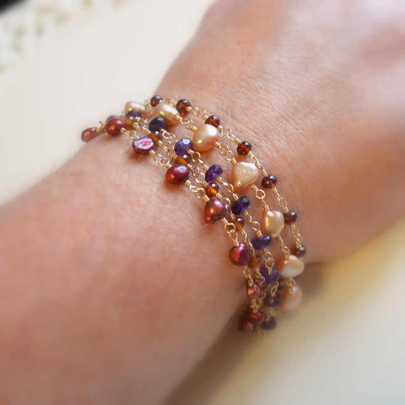 Multi Strand Bracelet with Garnet, Spessartite Garnet, Amethyst and Freshwater Pearls in Gold - product images  of