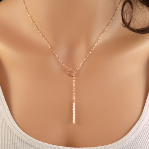 Simple,Lariat,Necklace,in,Rose,Gold,with,White,Pearls,pearl lariat, pearl necklace, pearl jewelry, white pearl, simple lariat, rose gold lariat, rose gold necklace