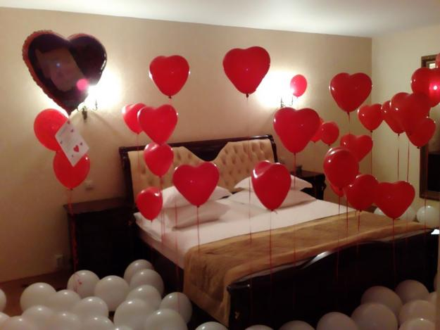 Valentines Helium Balloons on a bed