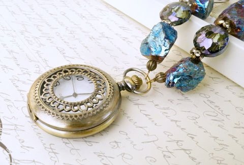 Enchanting,Blue,Pocket,Watch,Necklace,,Titanium,Plated,Quartz,Jewelry,Necklace,pocket_watch,necklace,titanium_plated,rose_quartz,watch_necklace,steampunk_necklace,gear_necklace,edwardian_necklace,watch_jewelry,steampunk_fashion,statement_necklace,crystal_necklace,handcrafted_necklace