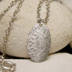 Tiny,Sterling,Silver,Oval,Necklace,with,Trailing,Rose,Texture,handcrafted sterling silver necklaces, Pendants, sterling silver,  silver pendant,  silver rose, rose necklace,  tiny oval charm, oval pendant, dainty silver, silver necklace, dainty necklace, necklace gift, gift for women, flower jewelry, simple rustic s