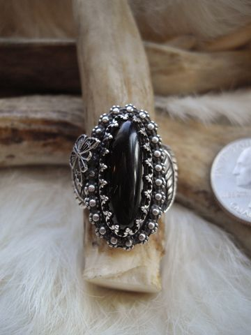 sterling,silver,ring,with,oval,,black,onyx,stone,sterling silver ring, flower ring, black stone ring, handmade rings, statement ring, butterfly ring, onyx stone, oval stone ring, floral ring, handmade, one of a kind, sterling silver