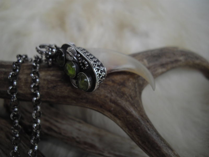 Genuine Cougar claw set in a sterling silver and Peridot pendant necklace - product images  of