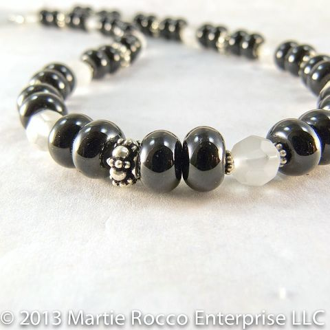 Black,Onyx,and,frosted,Quartz,necklace,with,sterling,silver,Black Onyx and frosted faceted Quartz beaded necklace with sterling silver