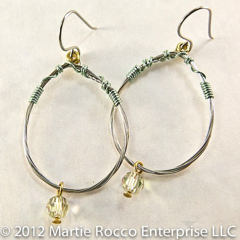 Guitar,String,oval,hoop,earrings,with,light,green,wire,wrap,and,a,crystal,guitar string earrings, repurposed, recycled, light green, crystal, wire wrapped
