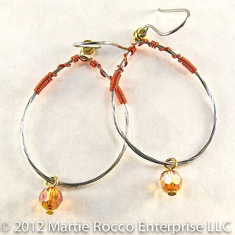 Guitar,String,oval,hoop,earring,orange,wire,wrap,and,crystal,guitar string earrings, repurposed, recycled, orange, crystal, wire wrapped