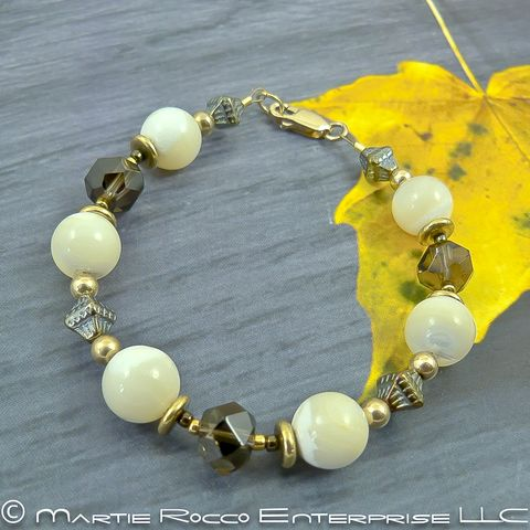 Mother,of,Pearl,bracelet,with,Smokey,quartz,,brass,,and,gold,filled,Mother of Pearl Smokey quartz brass bracelet.