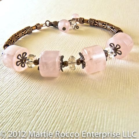 Rose,Quartz,bracelet,with,antiqued,copper,beads,and,clear,faceted,quartz.,Rose Quartz bracelet antiqued copper clear faceted quartz.