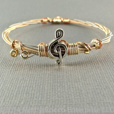 Guitar,String,bangle,,phosphorous,bronze,,pewter,treble,clef,bead,,copper,Guitar String bangle, phosphorous bronze, pewter treble clef bead, copper