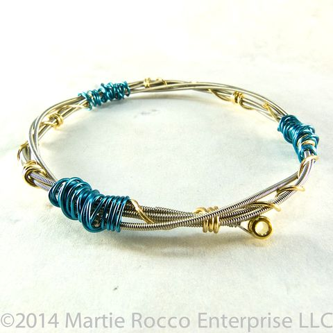 Guitar,String,Bangle,bracelet,double,coiled,brass,and,blue,wire,wrap,Guitar String Bangle bracelet double coiled brass and blue wire wrap