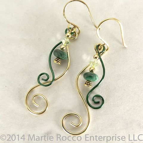 Malachite,and,crystal,earrings,with,gold,plate,green,wire,scrolls,Malachite and crystal earrings with gold plate and green wire scrolls