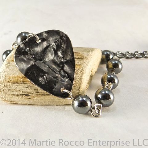 Black,pearl,guitar,pick,bracelet,with,hematite,beads,Black pearl guitar pick bracelet with hematite beads