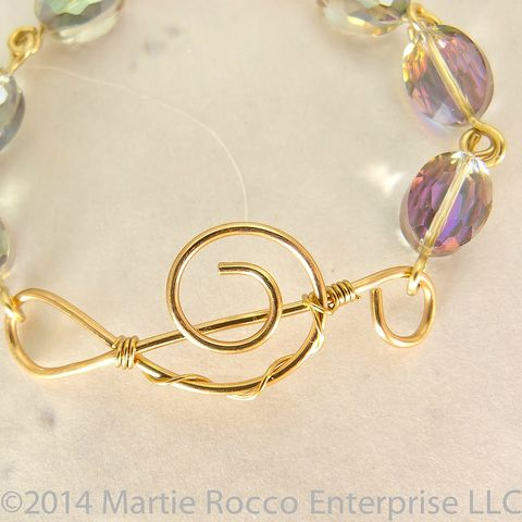 Treble,clef,gold,wire,music,bracelet,faceted,aurora,sparkly,oval,glass,Treble clef gold wire muisc bracelet faceted aurora sparkly oval glass