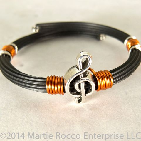 Pewter,Treble,clef,bracelet,orange,wire,wrap,rubber,tube,memory,Pewter Treble clef bracelet orange wire wrap rubber tube memory wire