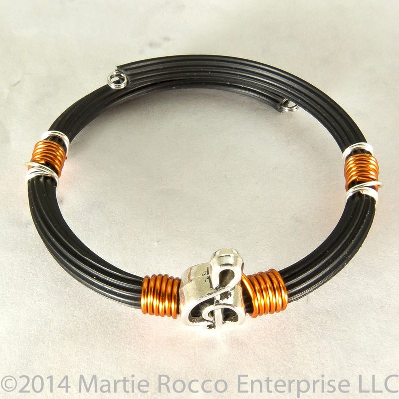 Pewter Treble clef bracelet orange wire wrap rubber tube memory wire  - product images  of