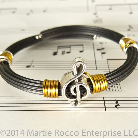 Pewter,Treble,clef,bracelet,bronze,wire,wrap,rubber,tube,memory,Pewter Treble clef bracelet bronze wire wrap rubber tube memory wire