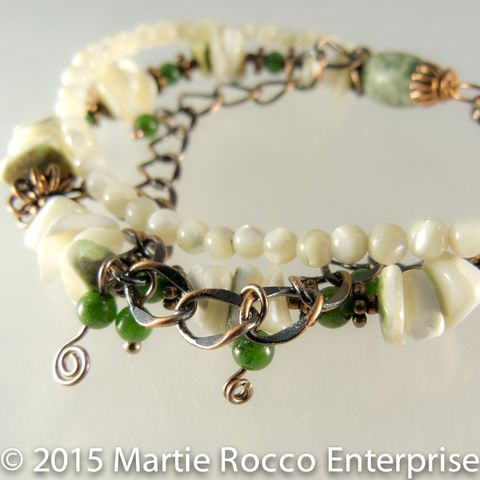 Shell,Jade,and,copper,multi,strand,bead,bracelet,Shell Jade and copper multi strand bead bracelet