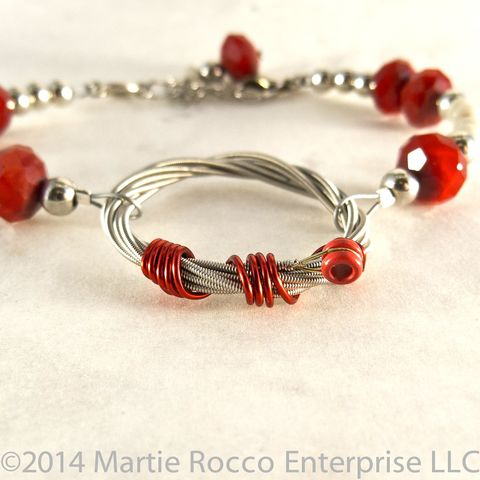 Red,and,grey,faceted,glass,Guitar,String,bracelet.,Red and grey faceted glass Guitar String bracelet.