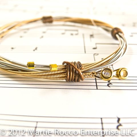 Guitar,string,bangle,phosphorous,bronze,steel,copper,wire.,Guitar string bangle phosphorous bronze steel copper wire.