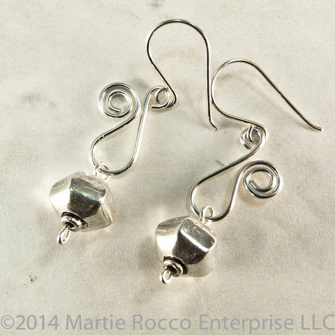 Sterling,Silver,earrings,with,wire,scroll,and,lantern,shaped,bead,drop.,Sterling Silver earrings with wire scroll and lantern shaped bead drop.