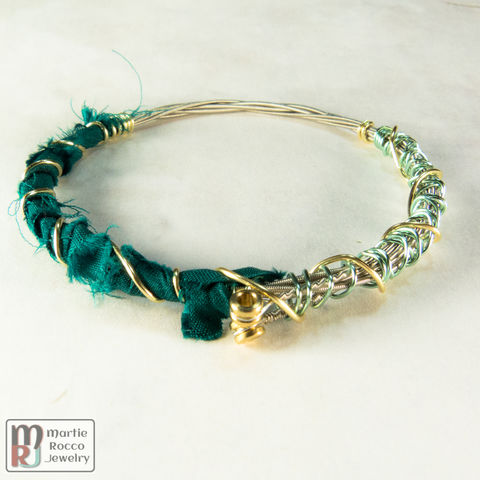 Guitar,string,bangle,bracelet,with,dark,green,silk,and,wire,wrap,Guitar string bangle bracelet with dark green silk and wire wrap