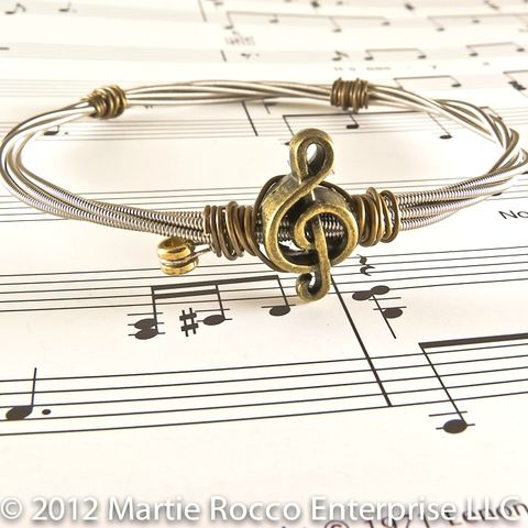 Guitar,String,bangle,antique,brass,treble,charm,and,wire,wrap.,Guitar String bangle antique brass treble charm and wire wrap.