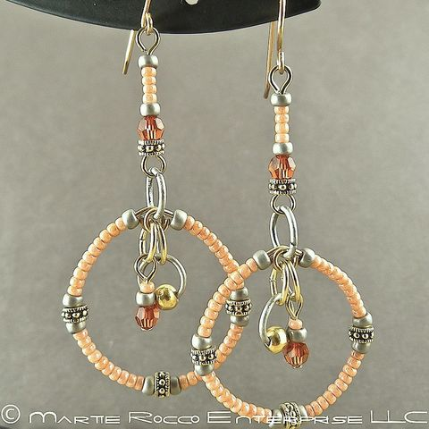 Long,peach,round,hoop,earrings,in,seed,beads,and,crystals.