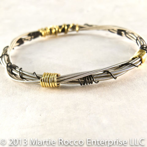 Guitar,String,Bangle,bracelet,double,coiled,gold,and,black,wire,wrap,Guitar String Bangle bracelet double coiled brass and black wire wrap