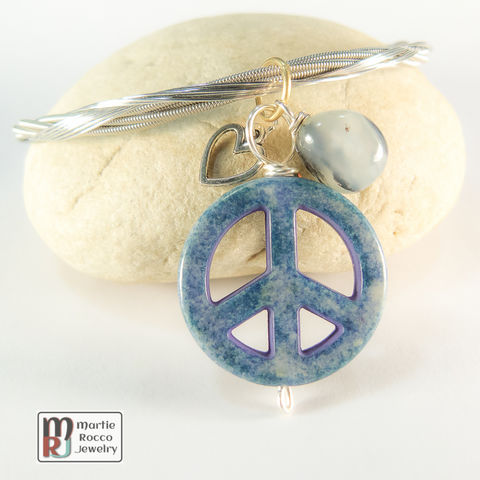 Guitar,String,Bangle,with,light,Blue,denim,color,Peace,charm,guitar string jewelry, guitar string bangle, peace, heart, charm, light blue, denim
