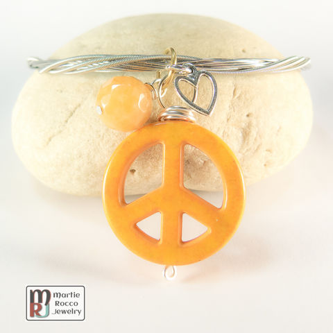Guitar,String,Bangle,with,Orange,Peace,charm,guitar string jewelry, guitar string bangle, peace, heart, charm