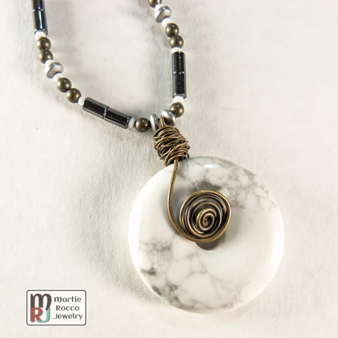 White,howlite,donut,pendant,necklace,White howlite donut pendant necklace with hematite and antique brass wire wrap and beads.