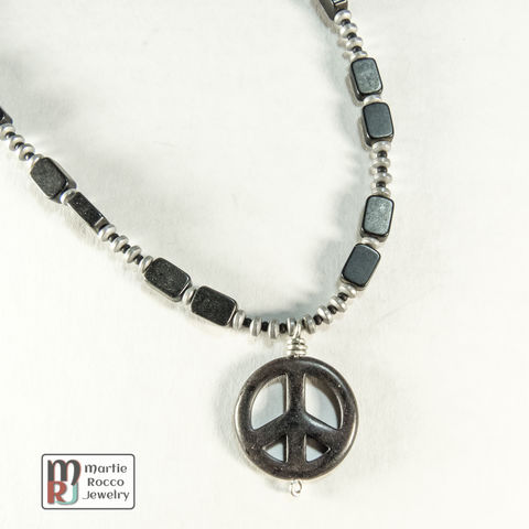 Black,peace,sign,pendant,necklace,with,jet,beads,Black peace sign necklace with jet beads