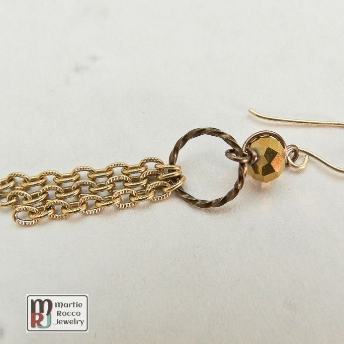 Gold mirrored faceted glass and chain dangle earring  - product images  of